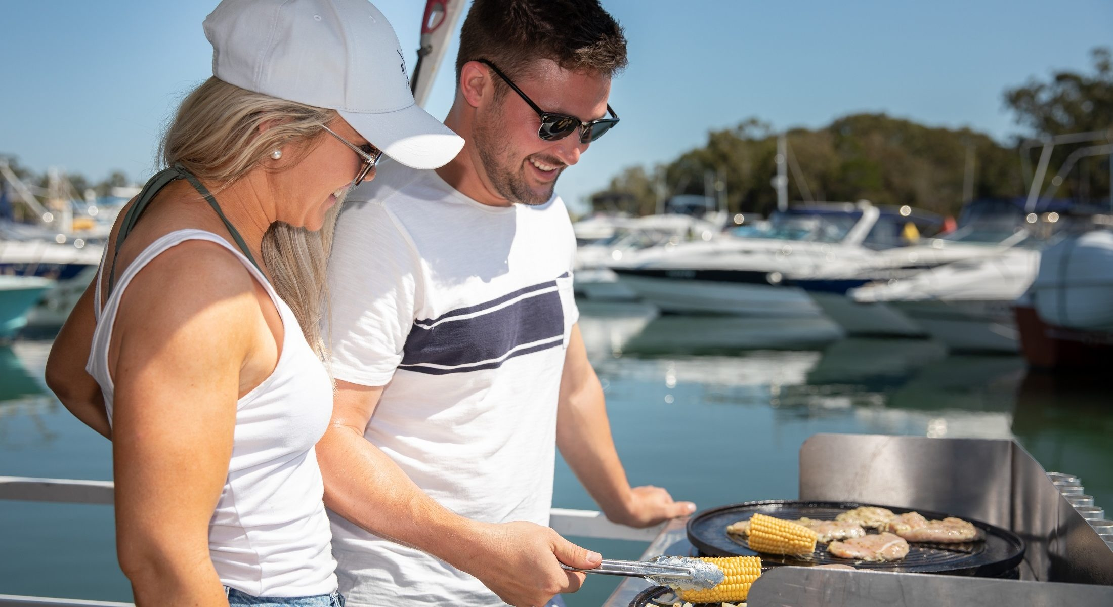 Bribie Bbq Boat Hire Couple Cooking Moreton Bay Region